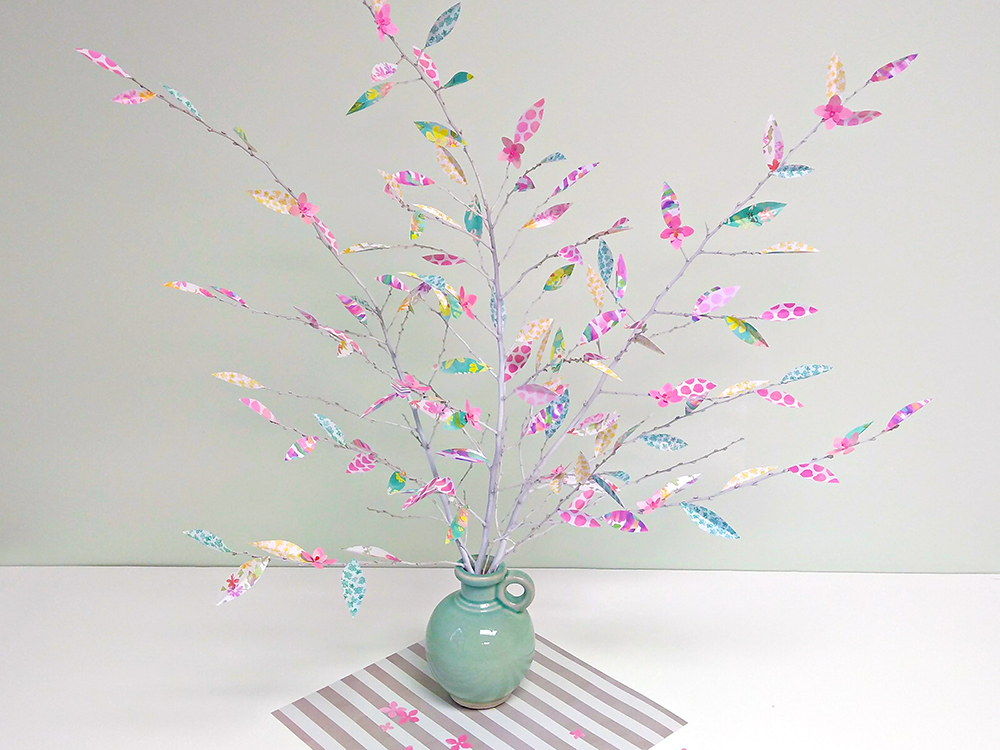 Usher in spring with this cute DIY! Make this Spring Tree using the AdTech® Crafter's Gift Pack, scrapbook paper and twigs. #hotglue #glue gun #scrapbooking #paperarts #eastercraft #springcraft #springdecor #diy