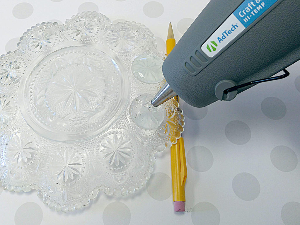 Apply AdTech hot glue to depression glass.