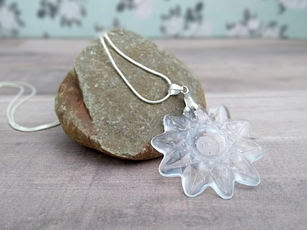 Make hot glue jewelry using old glass dishes as a mold.