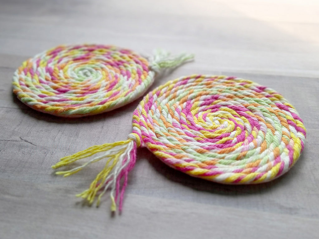 Make fun swirly coasters with scrap yarn, felt and AdTech hot glue.