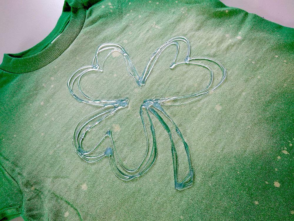 AdTech bleached DIY shamrock shirt with hot glue stencil for St Patrick's Day