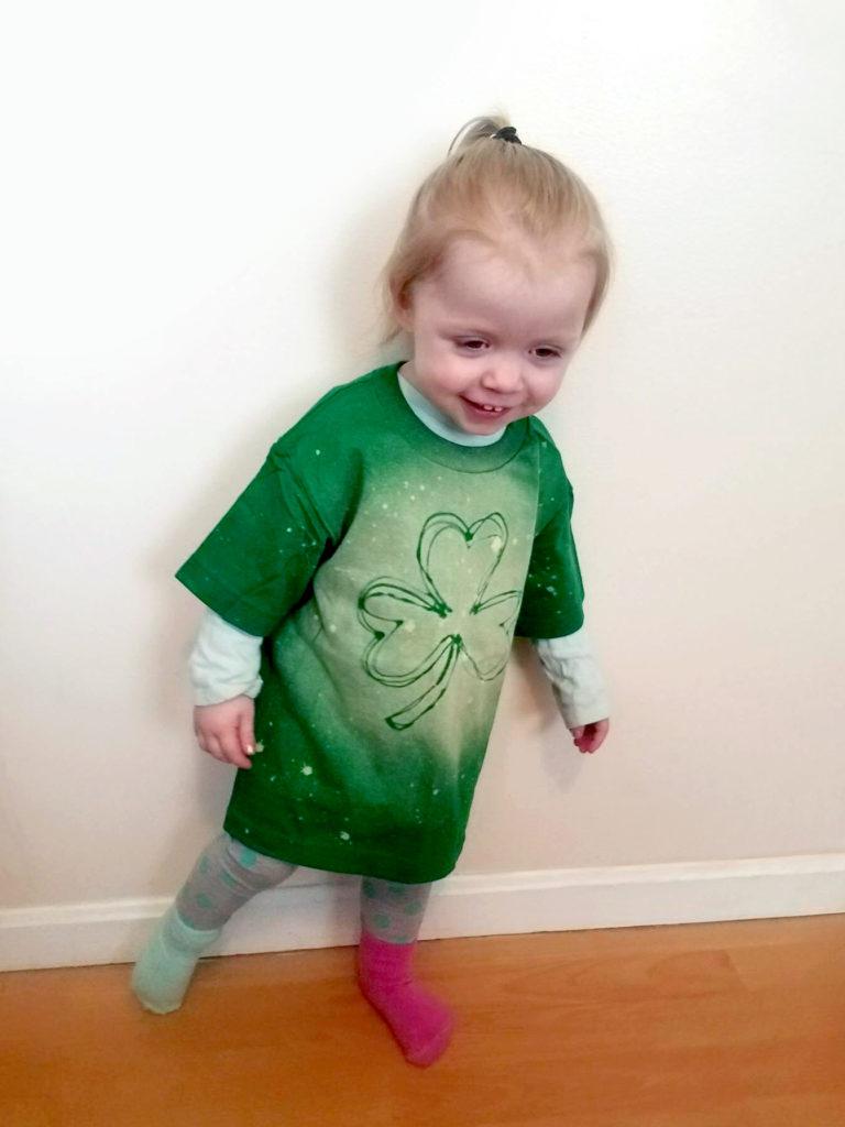 Little Leprecaun wearing DIY bleached hot glue stencil shirt