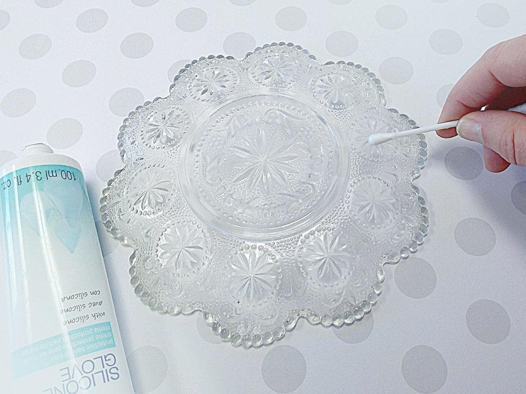 Remove Silicone Glove cream with cotton swab.