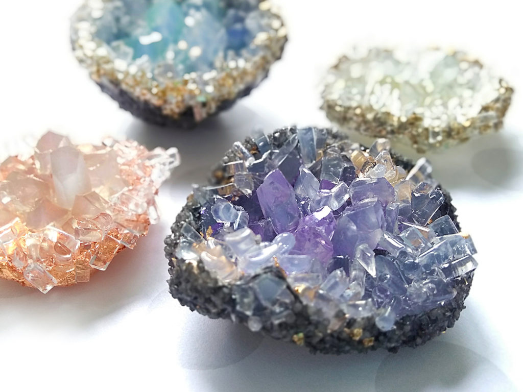 Make captivating geodes out of clear hot glue sticks and hot glue - in minutes! Visit the AdTech blog to learn how to make your own hot glue stick crystals and geodes - plus many more amazing projects! #hotglue #gluegun #gluesticks #geodes #crystals #adtech #thisishotglue #thestudio